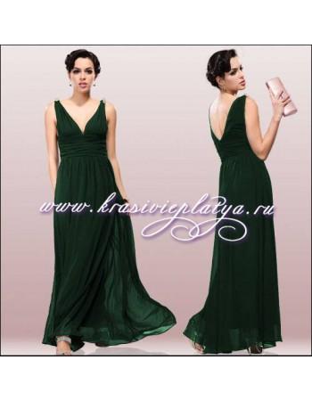 Элегантное зеленое шифоновое платье с украшением на плечах
